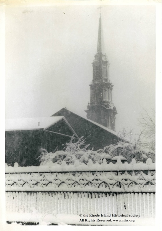Estey, Charlotte (photographer). [View of the First Unitarian Church and Unitarian Hall from Benevolent Street, looking towards Benefit Street in the snow]. Providence, Rhode Island. 1945-1955. Photograph: Silver gelatin. Mary Elizabeth Robinson Research Center, G Lot 144, Charlotte Estey Collection.