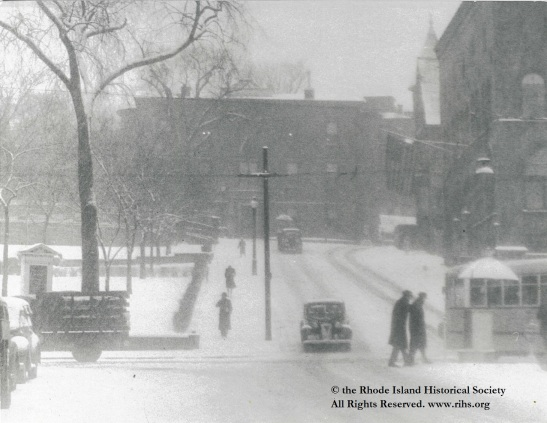 Estey, Charlotte (photographer). [ View up Waterman Avenue from North Main Street in the snow]. Providence, Rhode Island. 1945-1955. Photograph: Silver gelatin. Mary Elizabeth Robinson Research Center, G Lot 144, Charlotte Estey Collection.